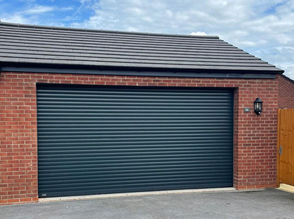 Black dark grey garage door brown brick modern contemporary Leeds