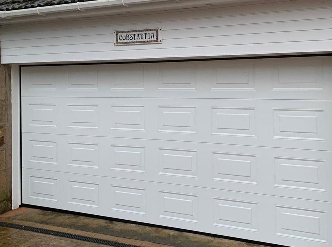White wide garage door new Wakefield