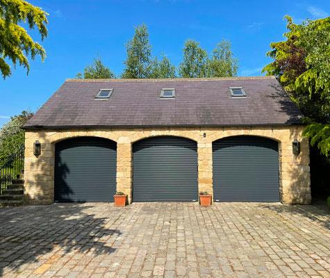 Black dark grey triple garage doors new modern contemporary Huddersfield