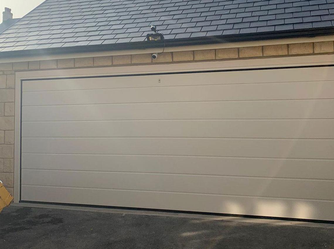 White wide garage door new Huddersfield