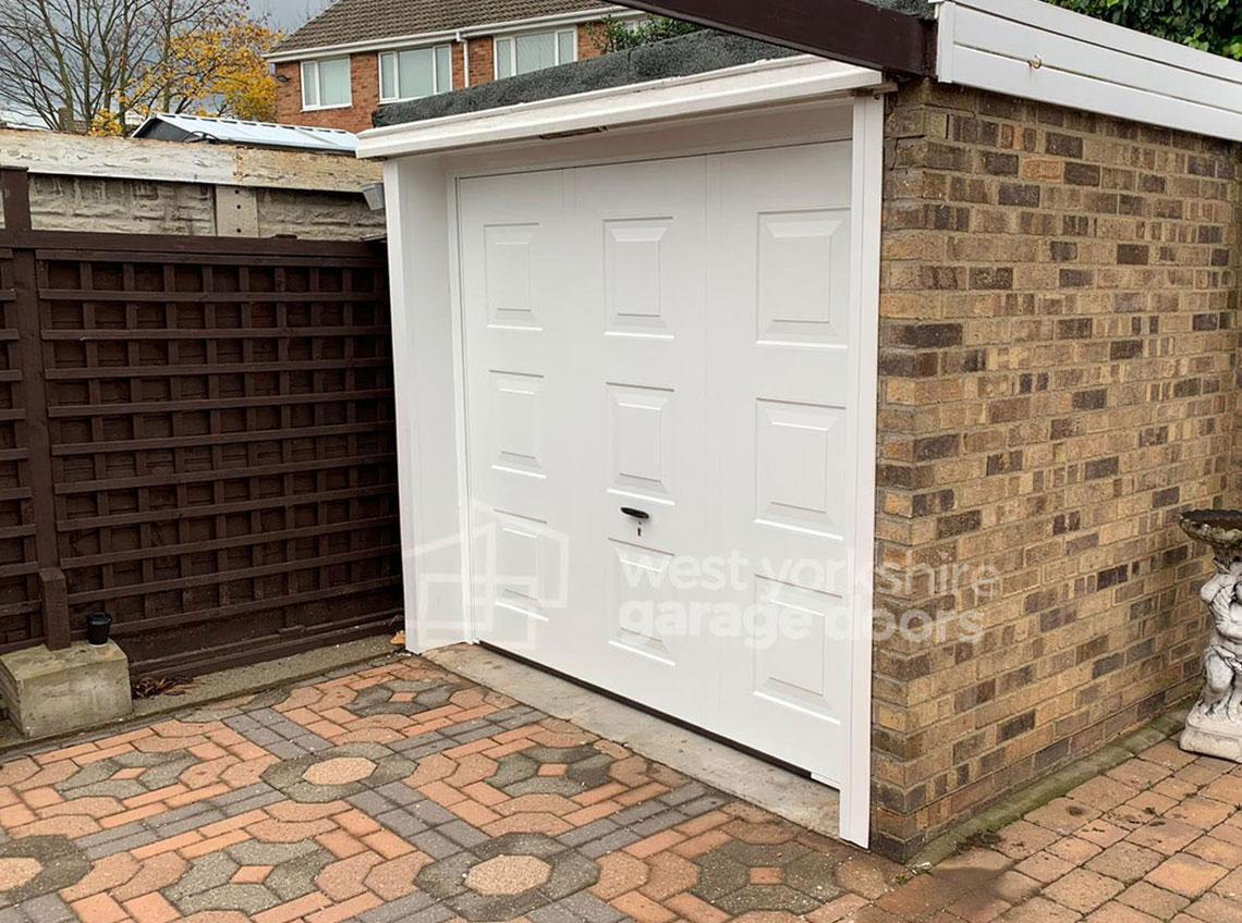 White small garage door new brown brick Wakefield