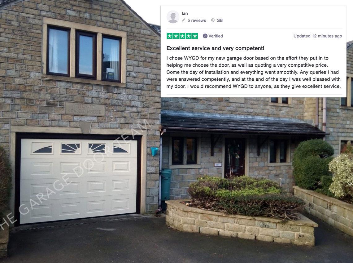 White garage door new brown brick house Huddersfield