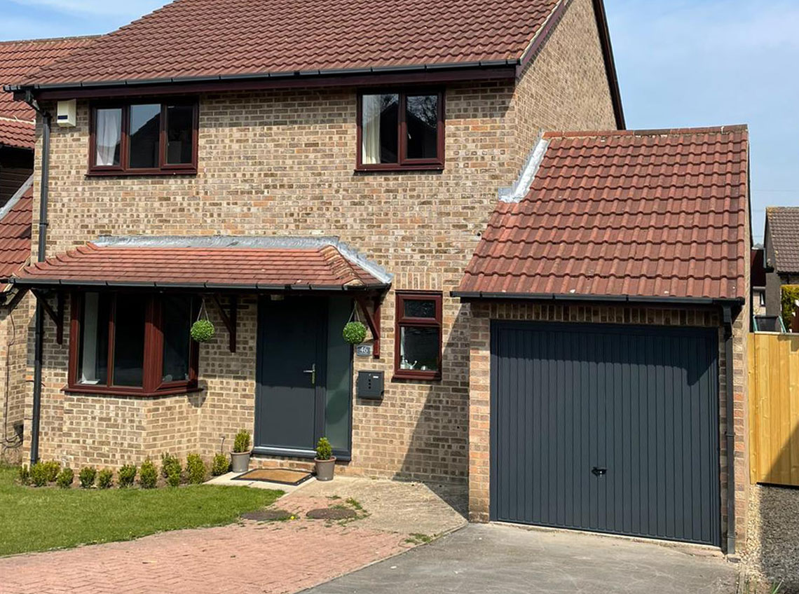 Black dark grey garage door modern contemporary new brown brick Pontefract